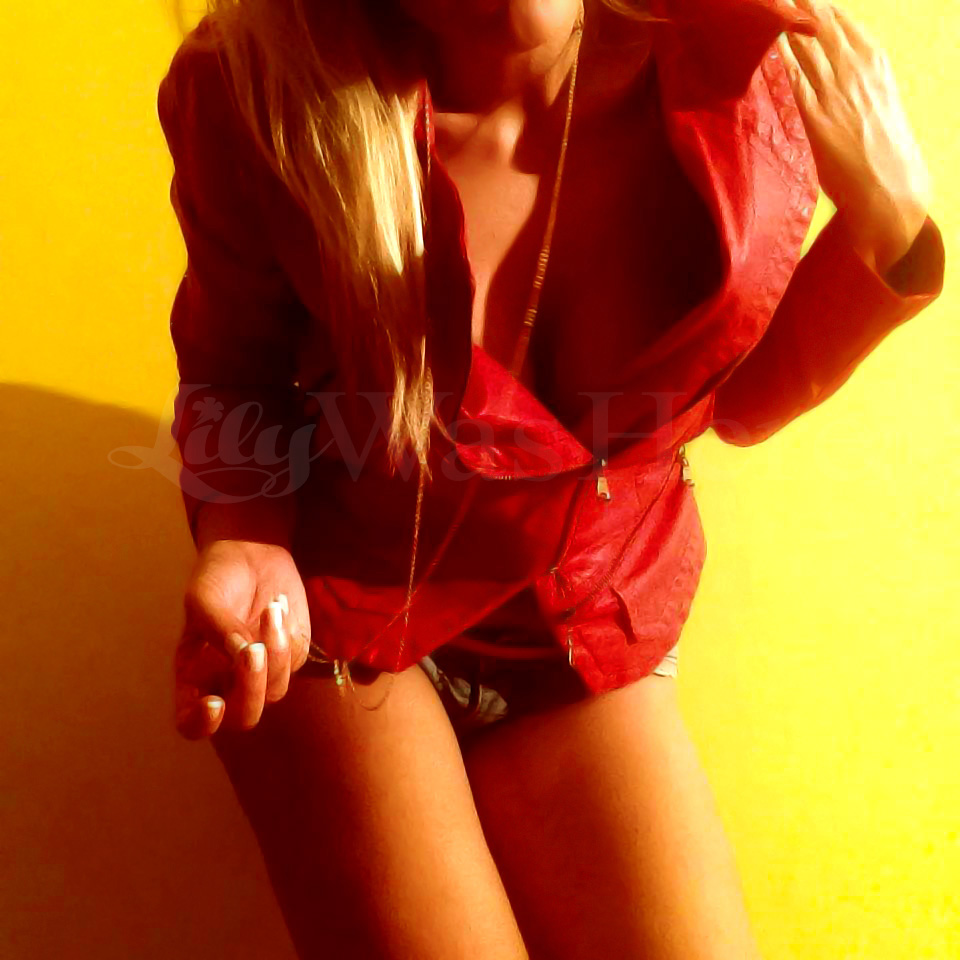 Red leather jacket and denim shorts